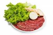 foto of korean  - Raw fresh thinly sliced meat with lettuce - JPG