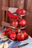 pic of serving tray  - Tasty ripe apples on serving tray on wooden background - JPG