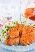 foto of thighs  - Chicken thighs marinated and baked in Russian dressing sauce served with rice and peas  - JPG