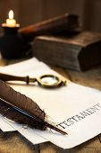 image of academia  - Historic parchment with text Testament candle feather and magnifier - JPG