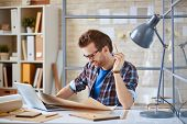 picture of draft  - Young businessman learning draft at workplace - JPG