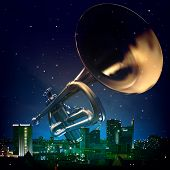 foto of trumpet  - abstract night blue background with city and trumpet - JPG