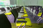 pic of training room  - Many yellow chairs arranged neatly in a training room - JPG