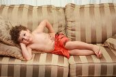 Young Child Laying On A Sofa