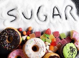 stock photo of addicted  - mix of sweet cakes donuts and candy with sugar spread and written text in unhealthy nutrition chocolate abuse and addiction concept body and dental care - JPG