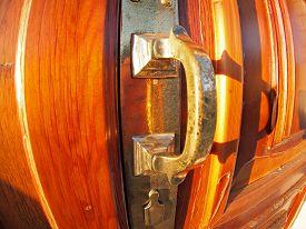 foto of distort  - Old bronze door handle close - JPG