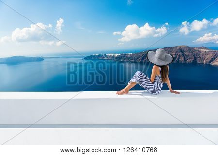 poster of Europe Greece Santorini travel vacation. Woman looking at view on famous travel destination. Elegant