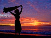 stock photo of beach sunset  - woman - JPG