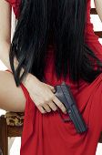 stock photo of woman legs  - Big black gun in womans hand closeup - JPG