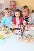 Children making watercolors with children