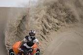 Teen Quad Rider Roosting The Dunes