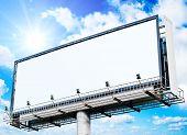 huge white blank billboard and a sun