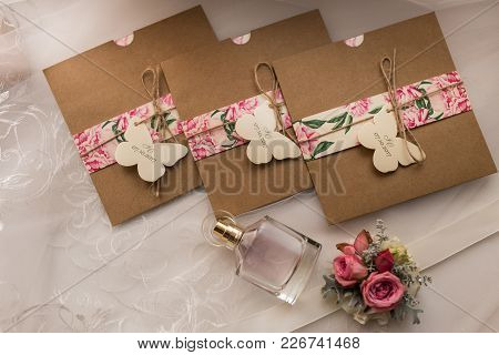 poster of Wedding Invitations In The Craft Envelopes. Wedding Concept. Wedding Accessories. Invitations, Perfu