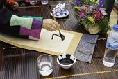 Calligrapher Painting Words On Paper. Calligraphy Is A Traditional Culture In Eastern Lunar New Year poster