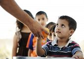 image of lineup  - Hungry children in refugee camp - JPG