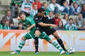 VIENNA,  AUSTRIA - JULY 26: Adil Rami (#4, Valencia) and Deni Alar (#33, Rapid) fight for the ball d