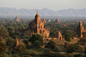 Group Of Ancient Pagodas At The Scenic Sunrise At  Myanmar. Landscape Of Many Ancient Buddhist Templ poster