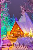 Travel Destinations Concepts. Unique Lapland Suomi Houses Over The Polar Circle In Finland At Christ poster
