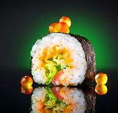 Sushi roll japanese food over black background. Sushi roll with tuna, vegetables, flying fish roe an poster