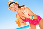 Blue Sea, White Sand Paradise. Full Length Portrait Of Happy Modern Woman In Colorful Red Beachwear  poster