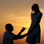 stock photo of marriage proposal  - Man proposing to girlfriend and offering engagement ring - JPG