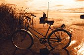 Bicycle And Fisherman