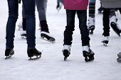 stock photo of skate  - Feet with skates on an ice rink - JPG