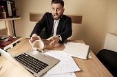 The Male Hands And Coffee In White Cup Spilling In Slow Motion Or Movement On The Table With Laptop  poster