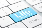 Insurance Concept: Computer Keyboard With Word Life Insurance, Selected Focus On Enter Button Backgr poster