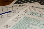 Calendar And Form 1040 Income Tax Form For 2017 Showing Tax Day For Filing Is April 17 2018 Usa Tax  poster