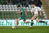KAPOSVAR, HUNGARY - JULY 30: Milan Peric (in green) in action at a Hungarian National Championship soccer game - Kaposvar (green) vs Videoton (white) on July 30, 2011 in Kaposvar, Hungary.