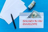 White Envelopes With Money Lie On A Black Wooden Table. Bribe In An Envelope. Salary In An Envelope poster