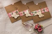Wedding Invitations In The Craft Envelopes. Wedding Concept. Wedding Accessories. Invitations, Perfu poster