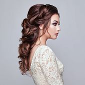 Brunette Woman With Long And Shiny Curly Hair. Beautiful Model Lady With Curly Hairstyle. Care And B poster