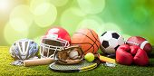 Close-up Of Various Sport Equipments On Pitch Against Bokeh Background poster