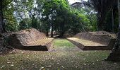 An Ancient Mayan Ball Court Sits At The Ruins Of Nim Li Punit In Southern Belize. poster