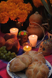 picture of sugar skulls  - Offering as part of the celebration of the day of the dead in Mexico with bread - JPG