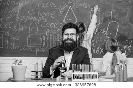 poster of School Teacher Of Biology. Man Bearded Teacher Work With Microscope And Test Tubes In Biology Classr