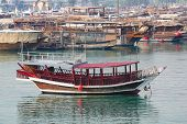 Traditional Boats Called Dhows Are Anchored In The Port Near Museum Of Islamic Art Park,doha , Qatar poster