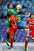 BARCELONA - APRIL 28: Juan Pablo Colinas(C) of Gijon block the ball between Damian(L) and Coutinho(R