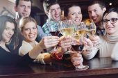 Group of happy young people drink wine  at party disco restaurant