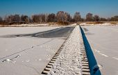 Wooden Walkway On The Snowy Ice