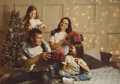 Gifts Time! Christmas Morning. Friendly Fashionable Family. Light Living Room At Home With Decorated poster