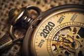 Expecting The New Year 2020 With A Metaphor Of Ticking Pocket Watch. poster