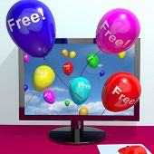 Balloons With Free Coming Through Computer  Showing Freebies and Promotions Online