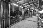 Empty Modern Pedestrian Walkway At Night In Black And White poster