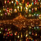 Buddha Image Surrounded By Candles And Colourful Lanterns. Beautiful Golden Buddha Image Lit By Cand poster