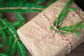 Christmas Gifts Box Presents On Brown Wooden Background. Wrapping Christmas Present In Craft Paper poster