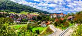 Travel and landmarks of Slovenia - beautiful  Zuzemberk medieval castle and village poster