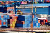 Stacked Cargo Containers In Storage Area Of Freight Sea Port poster